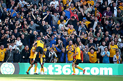 """Wolverhampton Wanderers' Ivan Cavaleiro (centre right) celebrates scoring his side's first goal of the game during the Premier League match at Molineux, Wolverhampton. PRESS ASSOCIATION Photo. Picture date: Saturday September 29, 2018. See PA story SOCCER Wolves. Photo credit should read: Nick Potts/PA Wire. RESTRICTIONS: EDITORIAL USE ONLY No use with unauthorised audio, video, data, fixture lists, club/league logos or """"live"""" services. Online in-match use limited to 120 images, no video emulation. No use in betting, games or single club/league/player publications."""