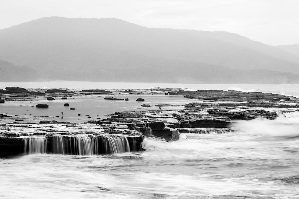 Coastal rockshelf and Durras Mountain from Depot Beach. Murramarang National Park.