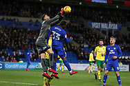 Angus Gunn, the Norwich city goalkeeper punches clear from Junior Hoilett of Cardiff city . EFL Skybet championship match, Cardiff city v Norwich city at the Cardiff city stadium in Cardiff, South Wales on Friday 1st December 2017.<br /> pic by Andrew Orchard, Andrew Orchard sports photography.