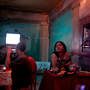 A Patron sings to his girlfriend in a karaoke bar on September 21, 2008 in Adriatico Street, Malate, Manila, the Philippines. Karaoke is extremely popular in the Philippines. Photo Tim Clayton