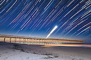 A series of over 200 images capture the movement of the stars and the rise of a crescent moon above Ocean Isle Pier just before sunrise.  Photo By:  Jeff Janowski