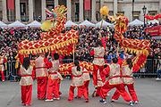 The Dragon Dance is performed in Trafalgar Square - Chinese New Year Celebrations in London 2018 marking the arrival of the Year of the Dog. The Event started with a Grand Parade from the North East side of the Trafalgar Square and finishing in Chinatown at Shaftesbury Avenue. It was organised by London Chinatown Chinese Association and is supported by The Mayor of London and Westminster City Council.