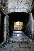 Arch and tunnel, paved streets of old Korcula town. Korcula old town, island of Korcula, Croatia