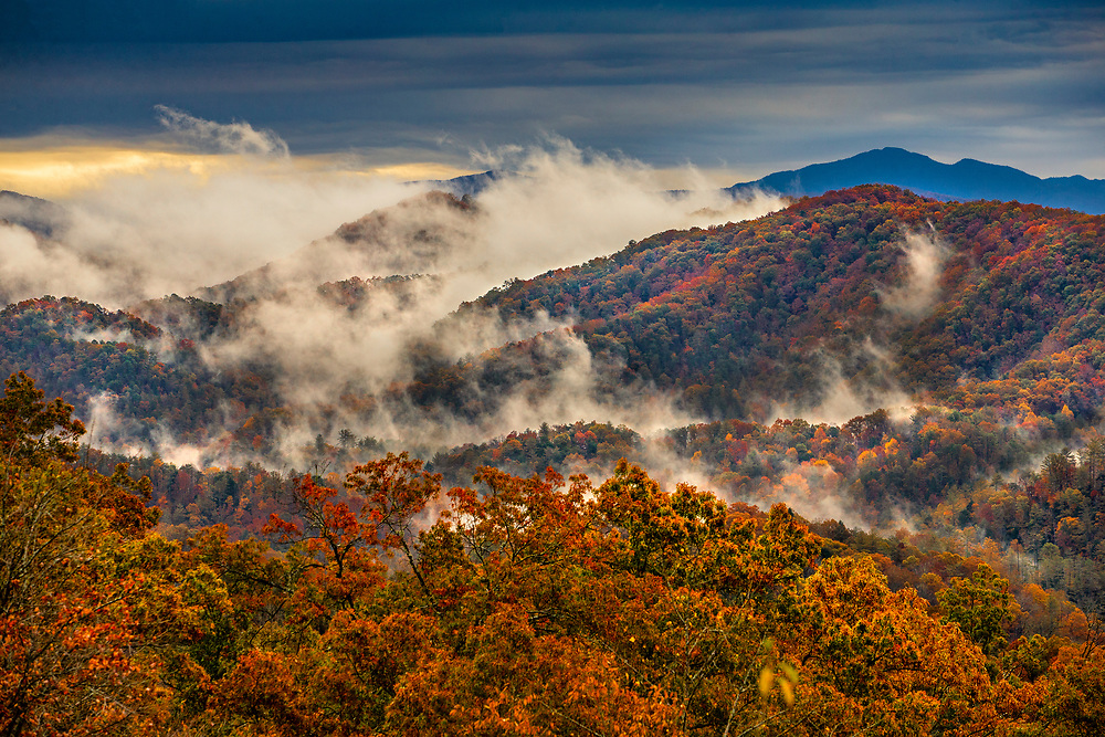 Fog rises over the Great Smoky Mountains at sunrise along the Foothills Parkway near Townsend, Tennessee.