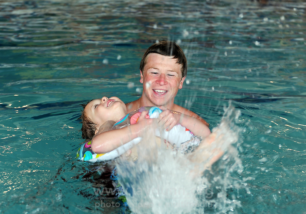 """Mason Moore, 4, has a whale of a time learning to swim under the guidance of instructor Michael Robinson during spring break """"Splash Week"""" at the Salinas Community YMCA."""