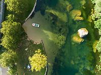 Aerial view of small boat anchored at Cetina river, Blato Na Cetini, Croatia.