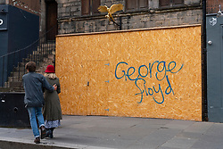 Edinburgh, Scotland, UK. 16 June, 2020. As shops open in England, Scottish shops and businesses remain closed, Streets are empty and pubs and shops are still closed with many boarded up. Bars might be allowed to open outside areas at end of week but currently they are only-permitted  to serve drinks to takeaway. Pictured; George Cole Black Lives Matter graffiti on boarded up business on the Royal Mile. ain Masterton/Alamy Live View.
