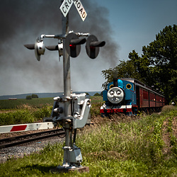 Strasburg, PA, USA - June 21, 2013: Thomas the Tank Engine chugs along the Strasburg Rail Road tracks in rural Lancaster County.
