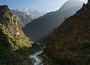 The peak of Thamserku (21,680 feet / 6608 meters elevation above sea level) rises 13,000 vertical feet above the Dudh Khoshi (Imja Khola) river, near Benkar (8629 ft / 2630 m), in the Khumbu District of Nepal.