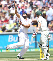 © Licensed to London News Pictures. 27/12/2013. Monty Panesar bowling during Day 2 of the Ashes Boxing Day Test Match between Australia Vs England at the MCG on 27 December, 2013 in Melbourne, Australia. Photo credit : Asanka Brendon Ratnayake/LNP