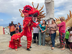 Nadia Dudkin and Maeven Parsil entertain the crowd as a Chinese Dragon and ring in the Chinese New Year.  It's Chinese New Year at the Nirvana Healing Temple.  29 January 2017.  St. Thomas, USVI.  © Aisha-Zakiya Boyd