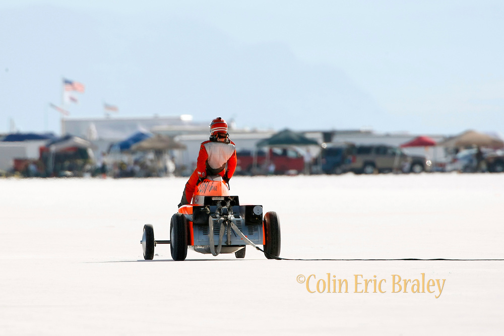 Best-cars-people-atmosphere-photos of 2009 Bonneville Speed Week- Robert Blakely of Houston, TX. climbs out of his BMC Special after a record run at the Bonneville Speed Way. August 9, 2009. Blakely captured a new land speed record of 235.437 mph.  Photo by Colin E. Braley