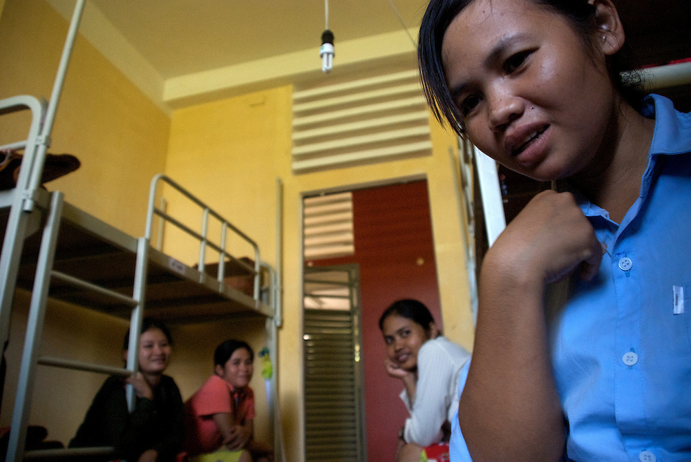 Varee (far right), nineteen-years old, rests before her afternoon courses with fellow classmates at the Provincial Teacher Training College in Siem Reap, Cambodia.  She took a test to gain admission to the free school, and hopes to teach in Cambodia once she finishes her course of study.