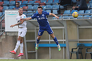Cove Rangers' Connor Scully (4) and Peterhead's Josh Mulligan (2) battles for possession, tussles, tackles, challenges, during the Premier Sports Scottish League Cup match between Peterhead and Cove Rangers at Balmoor, Peterhead, Scotland on 17 July 2021.