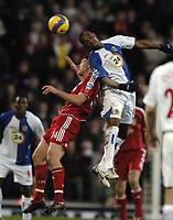 Photo: Jonathan Butler.<br />Blackburn Rovers v Liverpool. The Barclays Premiership. 26/12/2006.<br />Aaron Mokoena of Blackburn out jumps Steve Finnan of Liverpool.