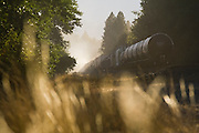 A train, pulled by a locomotive, travels down the Burlington Northern Santa Fe (BNSF) Railway along the Yakima River outside Cle Elum, Washington.