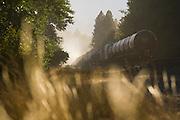 A train, pulled by a locomotive, travels down the Burlington Northern Santa Fe (BNSF) Railway along the Yakima River outside Cle Elum, Washington.