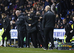 Wolves Manager Nuno Espirito and staff celebrate Matt Doherty scoring his side's second goal of the game as Reading Manager Jaap Stam watches on during the Sky Bet Championship match at the Madejski Stadium, Reading.