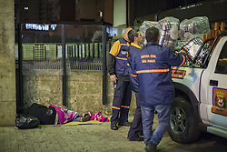 July 19, 2017 - Sao Paulo, Sao Paulo, Brazil - Jul 19, 2017 - Sao Paulo, Sao Paulo, Brazil - Civil Defense agents from the city of Sao Paulo bring blankets donated by a private company to the city hall to be delivered to the homeless who sleep in front of a subway station. Mayor JOAO DORIA was on hand to deliver but was harassed by some of the homeless and by protesters who criticized the lawsuit claiming it was pure marketing action and accused the ruler of attacking the same homeless who benefited At that moment when the press was present. (Credit Image: © Marcelo Chello/CJPress via ZUMA Wire)