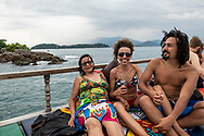 Brazilians enjoy a popular boat day trip to several beaches and swimming areas in Paraty, Rio de Janeiro State, Brazil. (March 17, 2019)