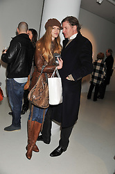MICHAEL HYDE and ISABEL VOSPER at a private view of Bill Wyman - Reworked held at the Rook & Raven Gallery, 7 Rathbone Place, London W1 on 26th February 2013.
