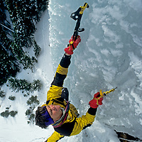 """ICE CLIMBING. Alex Lowe (MR) on """"Come and Get It"""" in Hyalite Canyon, Montana."""