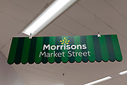 A sign for Market Street, the fresh produce section, inside popular British supermarket chain Morrisons on 23rd August, 2021 in Leeds, United Kingdom. British supermarket chain Morrisons, which employs over 110,000 staff across its 500 shops, has accepted a £6.3bn $8.7bn takeover bid from US private equity firm Fortress Investment Group.