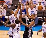 June 2, 2012; Oklahoma City, OK, USA; Oklahoma City Thunder center Kendrick Perkins (5) looks on as guard Russell Westbrook (0) blocks a shot taken by San Antonio Spurs center Boris Diaw (33)during the second half of a playoff game at Chesapeake Energy Arena.  Thunder defeated the Spurs 109-103 Mandatory Credit: Beth Hall-US PRESSWIRE