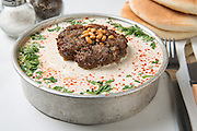 Seniyeh - Ground Lamb with Tahini a mideastern dish popular in Syria Lebanon and Israel Served with Pitah