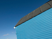 Beach hut and blue sky in Whitstable, United Kingdom. Whitstable is a seaside town on the north coast of Kent in south-east England. Whitstable is famous for oysters, which have been collected in the area since Roman times and are celebrated at the annual Whitstable Oyster Festival.