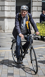 © Licensed to London News Pictures. 07/06/2017. Twickenham, UK. Liberal Democrat candidate Vince Cable arrives in Twickenham on his bike on the last day of the election before the polls open. Photo credit: Peter Macdiarmid/LNP
