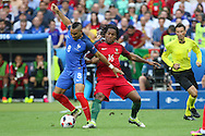 France Midfielder Dimitri Payet tackles and battles with Portugal Midfielder Renato Sanches during the Euro 2016 final between Portugal and France at Stade de France, Saint-Denis, Paris, France on 10 July 2016. Photo by Phil Duncan.
