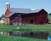 Amish barn with pond, farm just east of Berlin, Ohio.