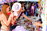 Hmong woman shop for jewelry and bling at outdoor concession stand. Hmong Sports Festival McMurray Field St Paul Minnesota USA