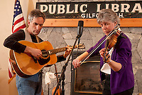 Ellen Carlson and Tim Mowry entertain at the Gilford Library with various fiddling tunes April 14, 2011.