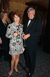 MR GEOFFREY ROBERTSON QC and his wife, writer KATHY LETTE at a gala dinner in the presence of HM Quenn Silvia of Sweden and HM Queen Noor of Jordan in aid of the charity Mentor held at the Natural History Museum, Cromwell Road, London on 23rd May 2006.<br />