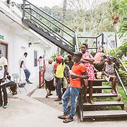 INDIVIDUAL(S) PHOTOGRAPHED: N/A. LOCATION: Sacré-Cœur Hospital, Milot Commune, Cap-Haïtien, Haïti. CAPTION: Friends and family of patients at the Orthopedic Department wait for them by the front entrance.