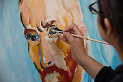 San Jose State University pictorial arts student Monica Gonzalez (Class of 2014) paints a portrait of Vincent van Gogh during Humanities & Arts Day Student Showcase at San Jose State University's Student Union Barrett Ballroom in San Jose, California, on October 25, 2013. (Stan Olszewski/SOSKIphoto)