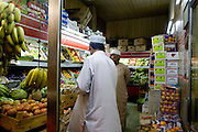 Muscat (Mutrah), Sultanate of Oman. .January 31st 2009..A fruit and vegetable retailer in Muscat (Mutrah) at night.