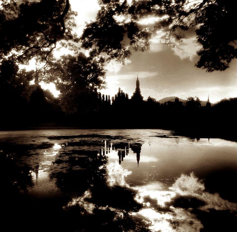 Wat Mahathat Across the Water at Sunset - Sukothai, Thailand