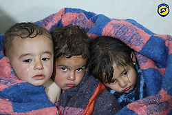 In this photo from the Syria Civil Defence, also better known as the White Helmets, Children, who are victims from a result of shelling with chemical materials of the town of AlHabeet are wrapped in a blanket. At least 58 people have been killed, and dozens wounded, including 11 children, in the early morning attack in a suspected chemical attack on a rebel-held town in north-western Syria. (Credit Image: © Syria Civil Defence via ZUMA Wire).