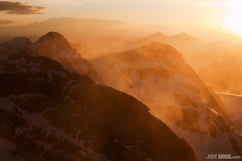 Grays and Torreys Peaks on the horizon are viewed at sunset from the summit of Mount Evans, Front Range, Colorado.