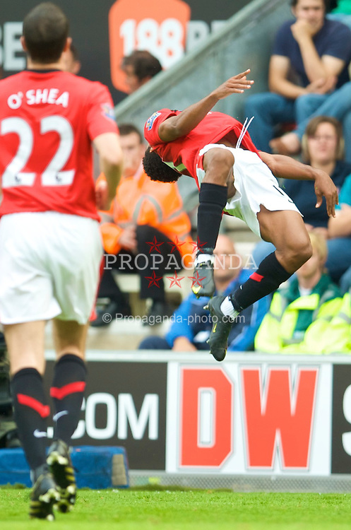 WIGAN, ENGLAND - Saturday, August 22, 2009: Manchester United's Nani celebrates scoring the fifth goal against Wigan Athletic during the Premiership match at the DW Stadium. (Photo by David Rawcliffe/Propaganda)