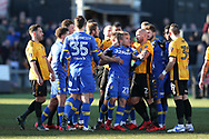 Robbie Willmott of Newport County (l) holds his shirt after he was spat on by Samual Saiz of Leeds Utd (c no21)  late in the match, leading to all the players getting involved in a scuffle and a red card for Leeds player Samual Saiz for spitting at Willmott. Emirates FA Cup , 3rd round match, Newport county v Leeds Utd at Rodney Parade in Newport, South Wales on Sunday 7th January 2018.<br /> pic by Andrew Orchard,  Andrew Orchard sports photography.