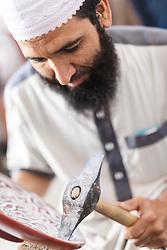 Craftsman working on ceramic pottery, Fes al Bali medina, Fes, Morocco