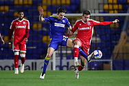 AFC Wimbledon midfielder George Dobson (24) tackling Gillingham FC midfielder Oliver Lee (11) during the EFL Sky Bet League 1 match between AFC Wimbledon and Gillingham at Plough Lane, London, United Kingdom on 23 February 2021.