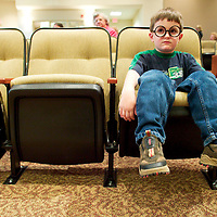 (PMONMOUTH) Tinton Falls 6/18/2003   Anthony Dennis 7 of Brick sits in a auditorium seat as he waits for the Harry Potter event to start.  He was only 1 of 4 children to attend.  Michael J. Treola Staff Photographer..MJT