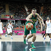 02 August 2012: Lithuania Jonas Valanciunas reaches for the loose ball during 82-74 Team France victory over Team Lithuania, during the men's basketball preliminary, at the Basketball Arena, in London, Great Britain.