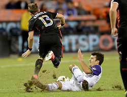 September 9, 2017 - Washington, DC, USA - 20170909 - Orlando City FC midfielder SERVANDO CARRASCO (5) trips up D.C. United midfielder PAUL ARRIOLA (13) with a hard tackle in the second half at RFK Stadium in Washington. Carrasco earned his second yellow card of the match on the play, and was ejected. (Credit Image: © Chuck Myers via ZUMA Wire)