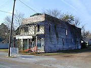 Old Bryant Store in Money Mississippi site of the Emmett Till murder.the old Bryant Store in Money, MS. from 11/27.02.The old Bryant store it has stood the test of time but is in bad shape and decaying. The store is where Emmett Till a young black man from chicago who stopped in the store and whistled or cat called at the oweners blonde and white wife,Emmett was later found lynched and the men who were accused of the crime were found not guilty.The store owners was Roy Bryant it was his wife that was whistled at and Roy owned the store with his half brother J.W.Milam in 1955. Bryant and Milam were indicted for kidnapping and lynching Till but were later acquited of all charges.(photo/Suzi Altman) Photo ©Suzi Altman Old Bryant Store in Money Mississippi site of the Emmett Till murder.the old Bryant Store in Money, MS. from 11/27.02.The old Bryant store it has stood the test of time but is in bad shape and decaying. The store is where Emmett Till a young black man from chicago who stopped in the store and whistled or cat called at the oweners blonde and white wife,Emmett was later found lynched and the men who were accused of the crime were found not guilty.The store owners was Roy Bryant it was his wife that was whistled at and Roy owned the store with his half brother J.W.Milam in 1955. Bryant and Milam were indicted for kidnapping and lynching Till but were later acquitted of all charges.(photo/Suzi Altman) Photo ©Suzi Altman